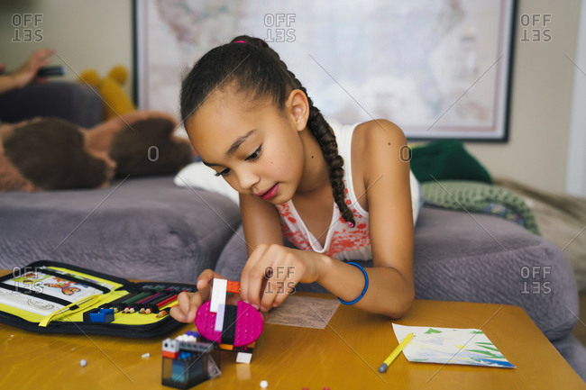 Tween Girl Playing with Building Blocks