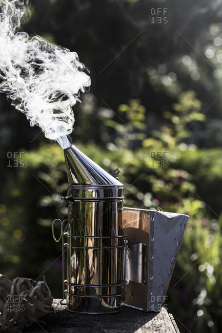 Close up of metal smoker used by beekeeper to calm bees.