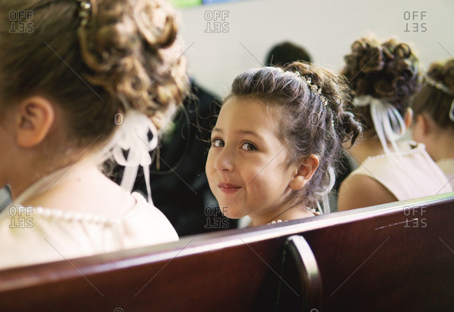 Young girl making a silly face during wedding ceremony