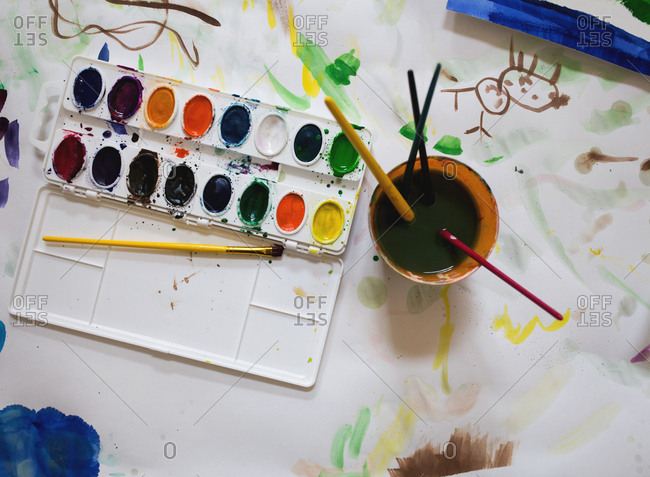 Palette of watercolor paint and brushes
