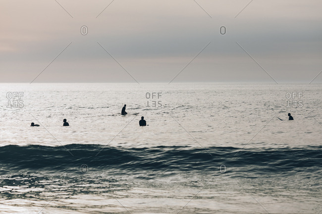 Group of surfers waiting for the next wave