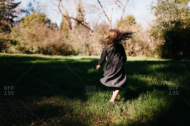 Little girl frolicking in nature