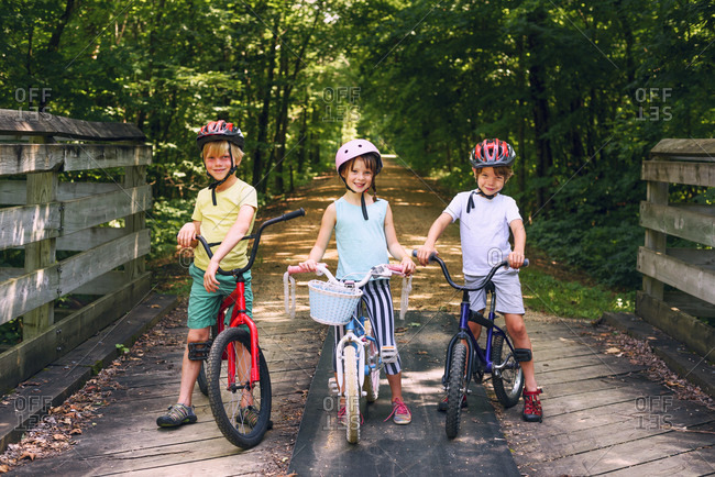 Group of young kids posing with their bikes