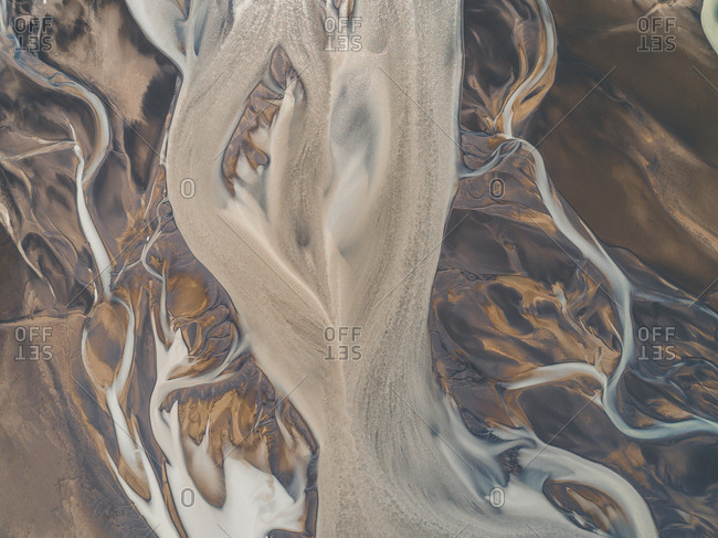Abstract aerial view of glacial streams and rivers flowing together