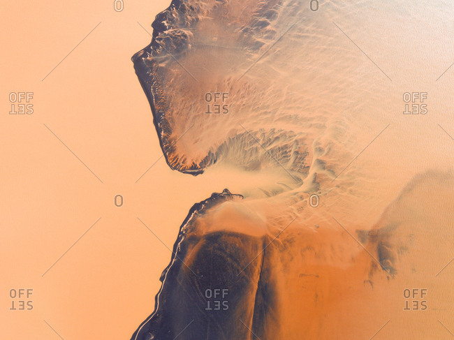 Abstract aerial view of glacier and glacial river