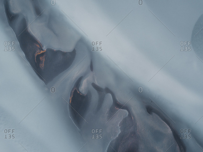 Abstract aerial view of icy water from glacial river