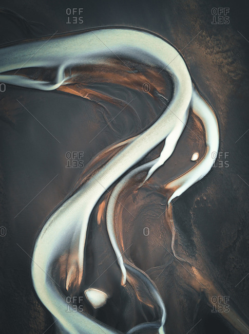 Abstract aerial view of winding glacial river