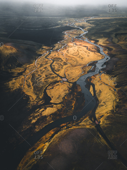 Aerial view of winding glacial river flowing through the Highlands of Iceland