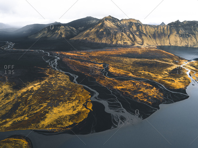 Scenic aerial view of glacier and glacial rivers in the interior mountains of Iceland