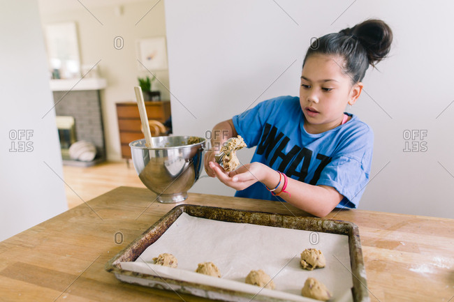 Girl making homemade chocolate chip cookies