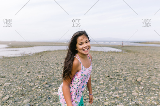 Smiling mixed race tween girl at the beach