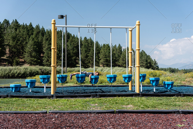 Young lying on equipment at a playground