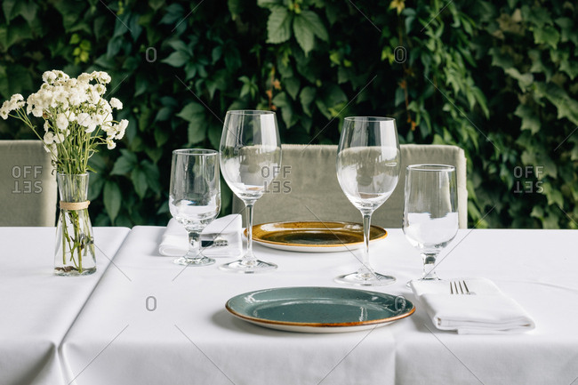 Drinking glasses and table setting on table