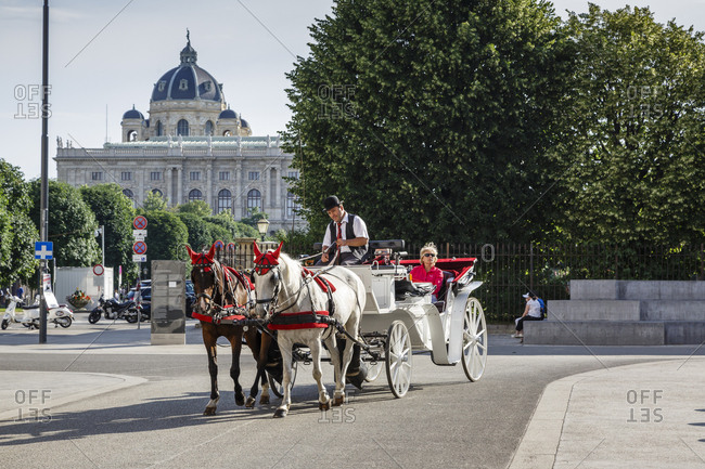 June 2, 2018: Horse drawn carriage with the Natural History Museum (Naturhistorische Museum) in the background, Vienna, Austria.