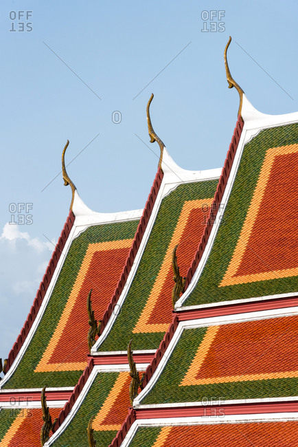 From above close-up view of sections of Buddhist temple roof with green and red pattern