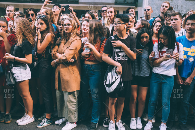 MILAN, ITALY - SEPTEMBER 23, 2018: large crowd of people waiting for blogger and models during Milan Fashion Week