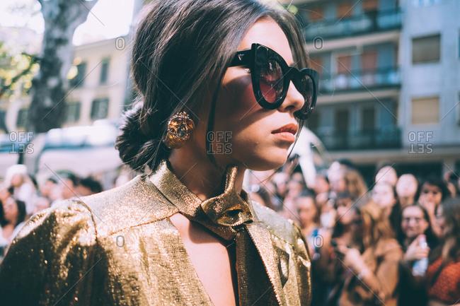 MILAN, ITALY - SEPTEMBER 23, 2018: fashionable woman attending fashion show during Milan Fashion Week Women Spring/Summer 2019