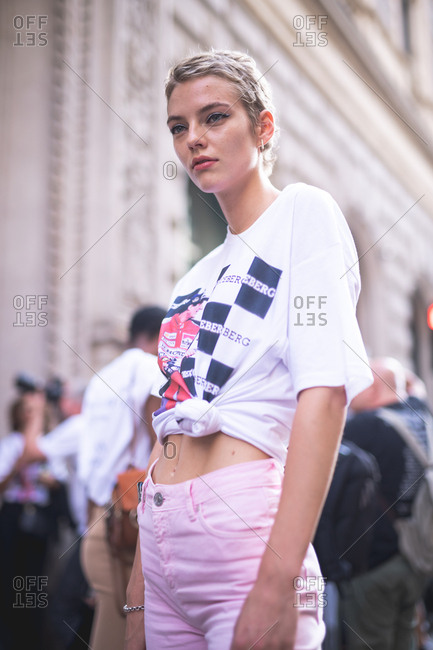 MILAN, ITALY - SEPTEMBER 23, 2018: Fashionable woman attending fashion show during Milan Fashion Week Woman Spring/Summer 2019