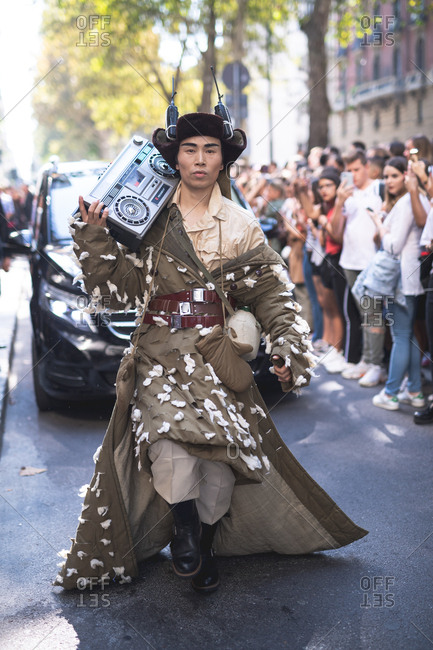 MILAN, ITALY - SEPTEMBER 23, 2018: Fashionable man attending fashion show during Milan Fashion Week Woman Spring/Summer 2019