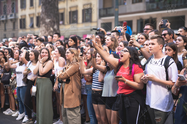 MILAN, ITALY - SEPTEMBER 23, 2018:Large crowd of people attending vip and celebrities at fashion show during Milan Fashion Week Woman Spring/Summer 2019