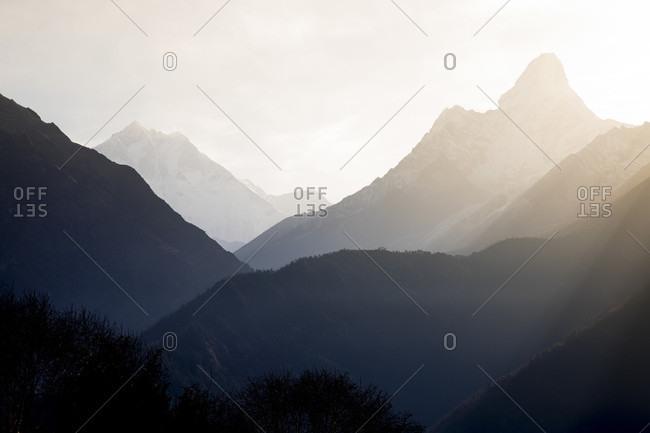 The sun rises over Ama Dablam in the Everest Region.
