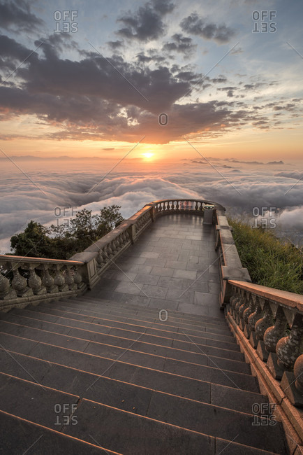 View of steps at Corcovado mountain above clouds at sunset, Rio de Janeiro, Brazil