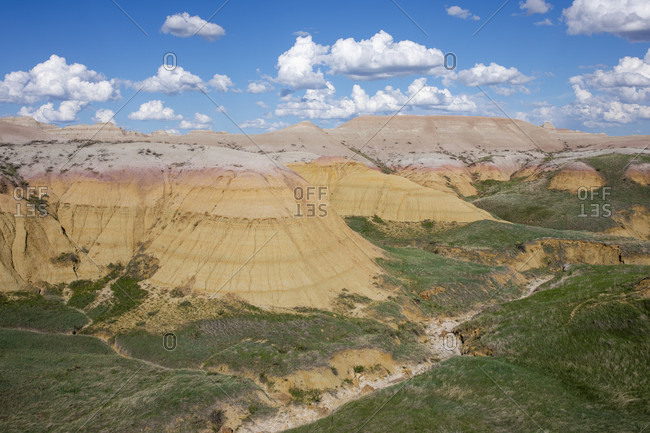 Scenic view of clouds over rock formations of Badlands National Park, South Dakota, USA