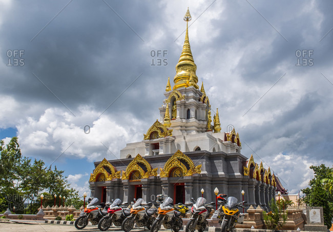 Group of motorcycles parked near stupa, Nan, Mueang Chiang Rai District, Thailand