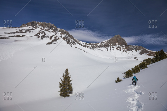 Distant view of mountaineer on approach to Donaldson Peak (right) in the Lost River Mountain Range, Idaho, USA