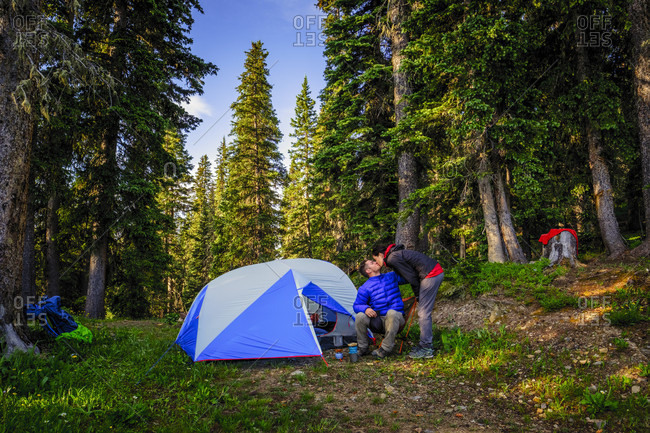 Backpackers kiss at Colorado Trail campsite.