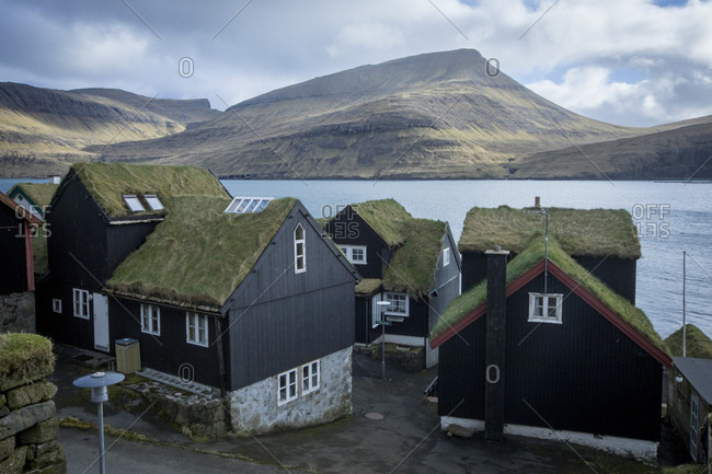 View of turf roof houses on seashore, Vagar, Faroe Islands