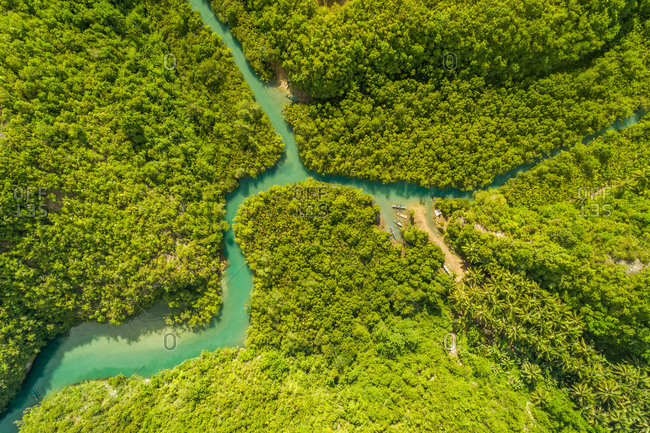 Aerial view of Bojo River and traditional fishing boat, Aloguinsan, Philippines.