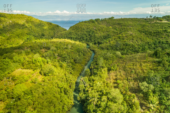 Aerial view of Bojo River and forest in Aloguinsan, Philippines.