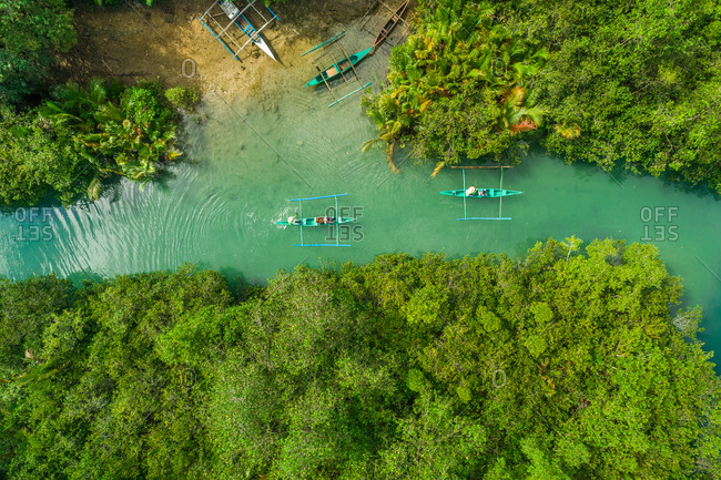 Aerial view of traditional fishing boats in Bojo River, Aloguinsan, Philippines.