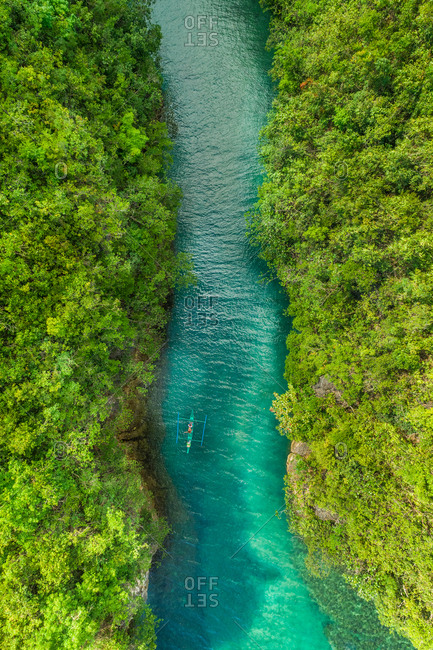 Aerial view of traditional fishing boat in Bojo River, Aloguinsan, Philippines.