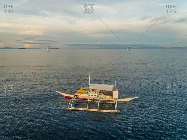 Aerial view of single filipino fishing boat near Lapu-Lapu city, Philippines.