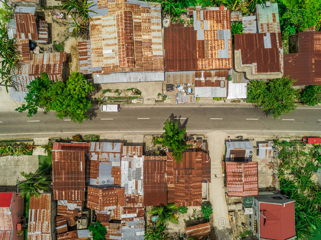 Aerial view of metal rooftops and road in Argao, Philippines.