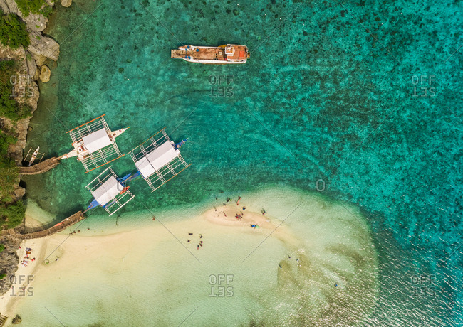 Aerial view of beach, pump boats and fishing vessel in Oslob, Philippines.