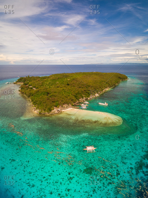 Aerial view of Sumilon Island and outrigger boats, Philippines.