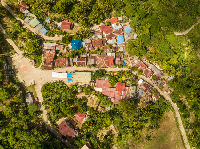 Aerial view of colorful rooftops and road in Dalaguete, Philippines.