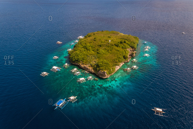 Aerial view of Pescador Island with traditional filipino boats, Philippines.