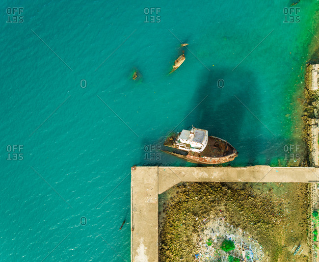 Aerial view of rusty shipwreck by Shell Island, Philippines.