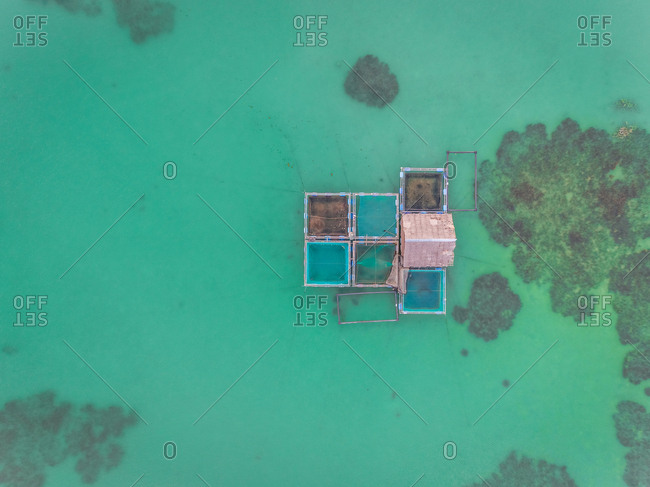 Aerial view of fish farm and coral reef near Tagbilaran city, Philippines.