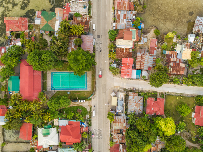 Aerial view of residential district with tennis court in Dauis, Philippines.