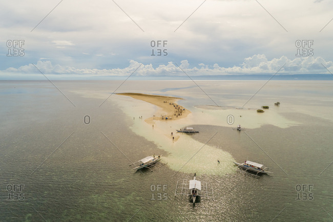 May 29, 2018: Aerial view of boats and people on sandbank in Panglao Island, Philippines.