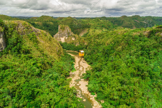 Aerial view of cable car above Inabanga river in Danao, Philippines.