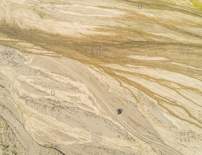 Aerial abstract view of one car in desert like landscape in Tarlac, Philippines.