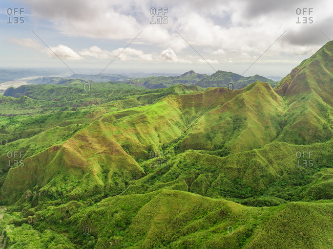 Aerial view of green hills in valley, Porac, Philippines.