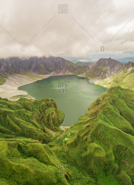 Aerial view of volcanic Lake Pinatubo and mountains, Porac, Philippines.