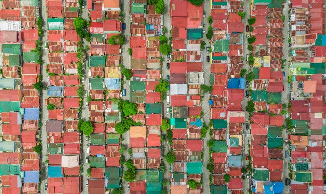 Aerial view of colorful roofs of residential district, Imus, Philippines.